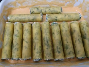 Cannelloni ripieni di ricotta e minestra maritata con besciamella alla zucca