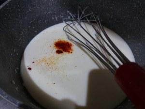 Timballo di tagliatelle con puntarelle salsiccia e crema di parmigiano allo zafferano